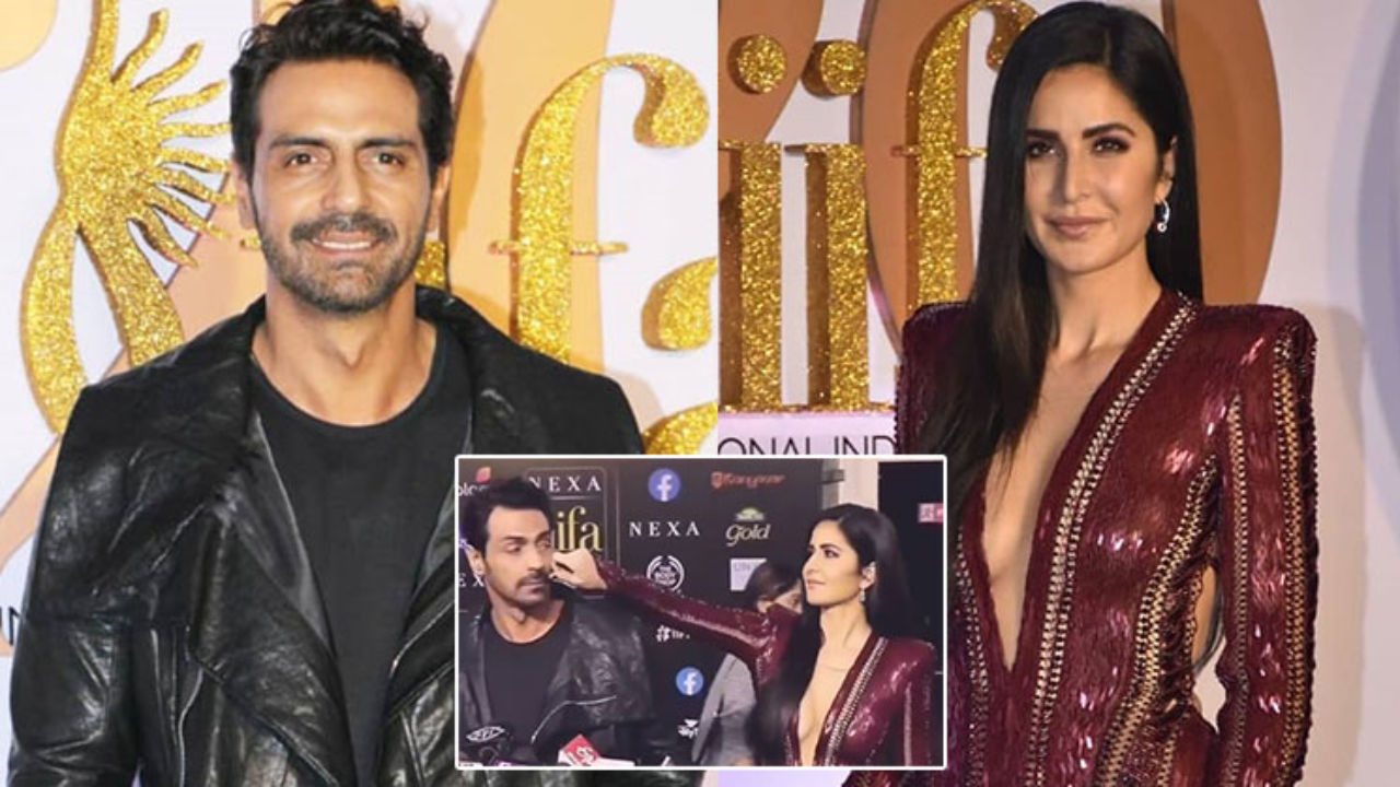 Image result for latest images of IIFA 2019: Katrina Kaif pulled Arjun Rampal's cheeks in the middle of a media interaction, watch