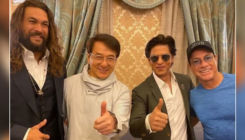 Shah Rukh Khan strikes a pose with Jackie Chan, Jason Mamoa and Jean-Claude Van Damme